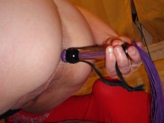 found a new use for my whip - used the handle to masturbate my ass until I squirted all over the place - do you like?