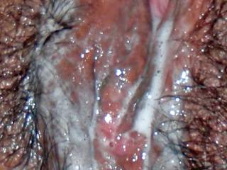 A close-up of my wife\'s sexy cum covered pussy!  I love vacation sex!!!