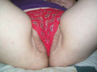 pull her panties to one side and lick her from ass to clit........sucking her pink lips into my warm mouth then sucking hard on her clit until she violently cums mmm
