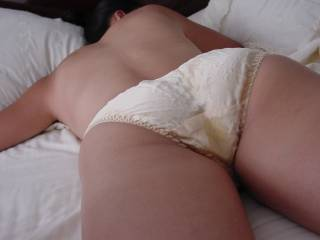 Our black friend had left my wife satisfied in our bed after a long hard fuck. His cum had made a big wet spot in her silk panties.