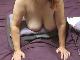 Kitten\'s beautiful tits hanging free