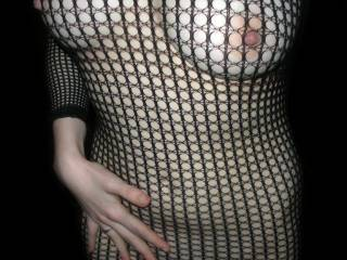 Amazing body and we love her beautiful tits and sexy nipples poking through the fishnet.  Awesome pic of this hottie.