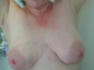 Heavy milk filled tits getting clean for you!