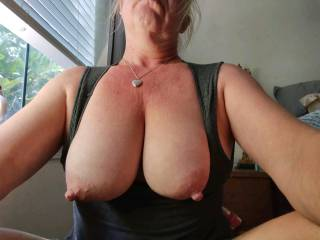 Tiny blonde wife with big tits.