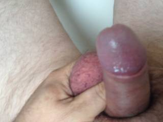 I had a firm grip of my testicle, I've just noticed how deep red my cock head is, it felt so good