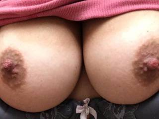 Wow!!  Absolutely amazing tits...perfect size, shape, big, dark aerolas and deliciously hard nipples begging to be licked, sucked and nibbled on!!