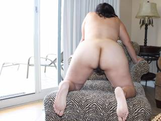 Posing nude by the window while on vacation!