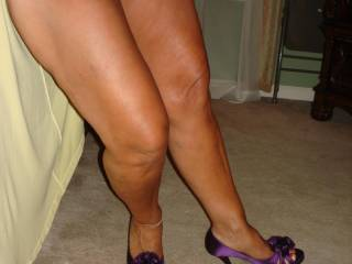 Oh! now this pic is just too sexy for words. I have this urge to spurt a hot load all over your belly as you stand there. I wonder how long it would take to roll down your soft skin and reach those purple heels?It would be fun to find out,don't you think? X