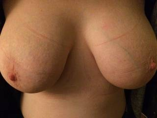 Squeezed into my bra for a 10 hour day at work. Just home and it feels so good to free my big, heavy tits. I think they need a good rub, and maybe some cream... They're so tender, can you do anything to help?