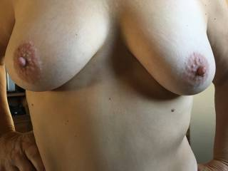 Flashed my husband while he was watching football.  He grabbed me and spent some time playing with them--just want I wanted.