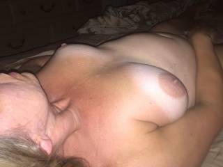 After fucking my wife hard in the arse, I came on her tits and face