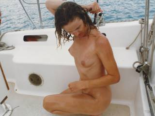 Sarah taking a shower on a yacht after being fucked bareback. Cum dribbled from her pussy. Tell us what you think of her?