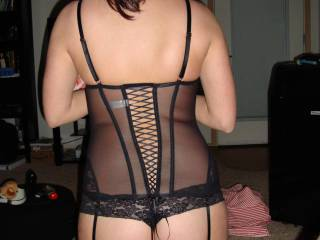 Picture of  Mistress sexy ass and bodyin a Corset, thighs highs and garters.