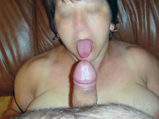 Licking his cock head