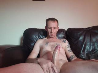 stroking my hard oiled cock for you