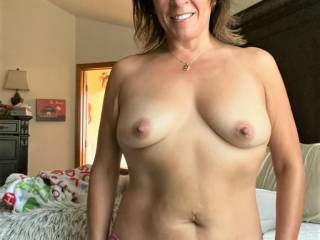 Melissa was getting ready for work, and I just had to take a quick pic before she put on any more damn clothes!