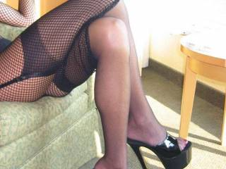 i'd have you take the shoes off and make you play with my cock with your feet, when im hard you can spread your legs, i'd pull your head forward and fuck your slut mouth, making you gag until i shoot my hot cum down your throat!