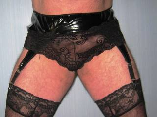 Showing off in my new PVC suspender belt and black lace panties.  What do you think?  Do you like them?  Let me knows guys & gals.