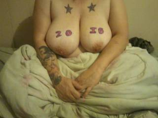 my girls boobs..and her tattoos...two stars, and a fairy
