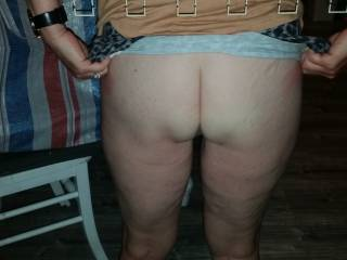 She is flashing her bum through the window at me. It was her sexy night out without panties or bra. Do you like her rear end ??
