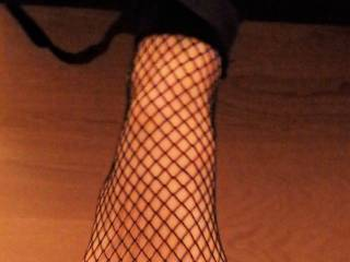 Fishnets on and tied to the bed. The fun can begin.