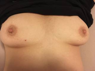 She asked to have her bush trimmed early one night and I didn't notice how hard her nipples got until I was done down below. They get to be the size of the JFK silver dollars when they are totally relaxed. Hmmm, next photo op!