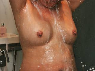 Continuing with coworker taking photos of me in shower in hotel during business trip.  Shampoo suds dripping down