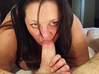 She's looking up at the stunt cock's face to see if he's close to cumming