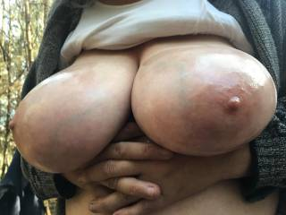 Fingers folded to support lovely big oiled tits