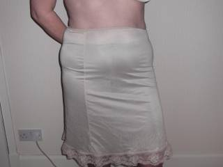 I'm with him but would his penis fit thru that little hole, love the idea though love your hips and slight rounded belly in your silky panties and slip!!