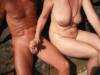 Playing with our nudist friend's lovely smooth tight cut cock at the local nude beach when it was quiet