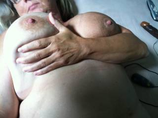 Hubby and I need to each suck on a nipple as we both finger your pussy and you play with our cocks!