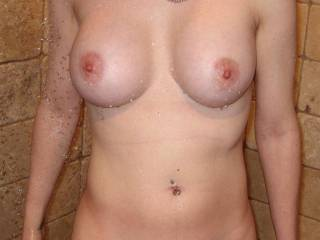 Really nice - titties and pussy. I'd like to cum on those, bathe those titties with my cum. But not in the shower. I want her to wear it for a while. But first, I would suck on that beautiful pussy and give her a cum; I really, really like that pussy!
