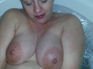 Lounging in the tubby... do you like my pregnant tits and belly?