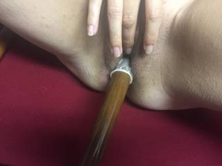 My wife naked on the pool table so I decided to fuck her with a pool cue