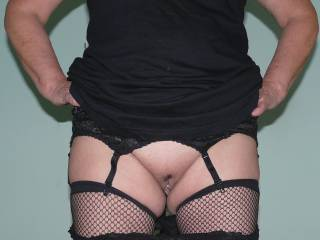 Little black dress, fishnets and lacy panties.