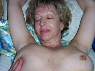 Beautiful tits and nips and what a wonderful expression on her face.