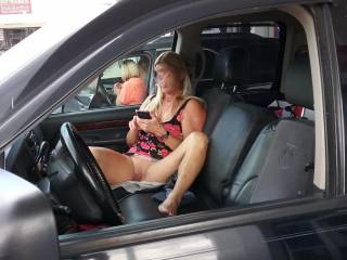 At the gas station her giving a tease to whoever was looking, I about shit when I came out of the store and seen her sitting in the truck like this and not sure if she realize how she was sitting until I took this pic, she was busy on the phone