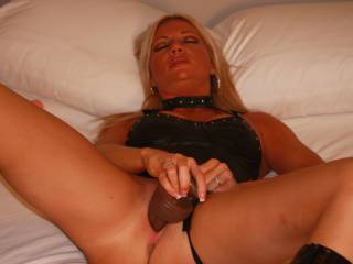 Wow, that's a very exciting pic! Wish i could replace this black dildo with my hard cock! Mmmm, it must feel so good inside her very inviting pussy!