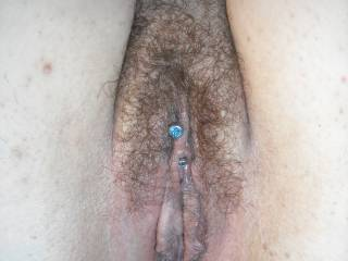 close up of hairy but trimmed pussy with piercing....