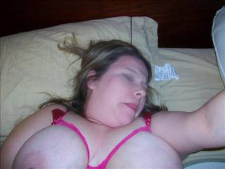 My chubby wife sticking her tongue out while I slide my cock in and out of her furry bush hole.