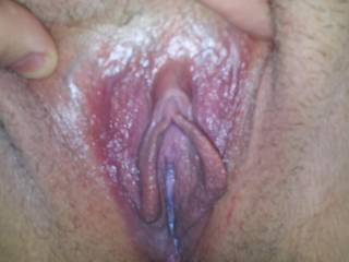 Wife\'s pussy. Looks a little wet in there.