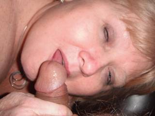 She just can't get enought of my cock tonight. I bet she would like a few more cocks to suck and drain of their cum in her mouth. Can anyone help us fill her mouth with cum or cock? love your comments and votes