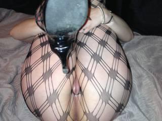 Fishnets, heels, pussy