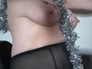 Festive sexercise... Sally rides her sexercycle wearing suspenders and tinsel... Seasons greetings to you all.