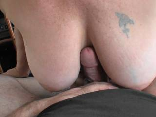 Just enjoying him tit fucking me. Love the way that big dick feels between my tits. What do you think of my tits and/or his dick?