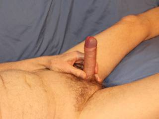 You have got me so aroused that my glans is pushing itself out from inside my foreskin. I am now ready to brush my glans across your clitoris and see where that leads.