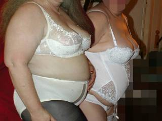 Im gonna guess the one on the right, i like her outfit...Once their hair was in pig or pony tails and i had one on each side, panties off and fighting for a bigger share of my cock, they would both be equally sexy as i fed and trained both their mouths ;)...