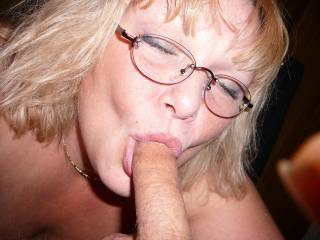 sucking long cock with glasses on
