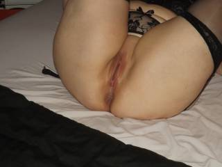 Stockings, suspenders, all shaved and ready to fuck...